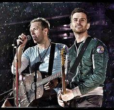 Chris Martin & Guy Berryman playing in the rain tonight! - June 19 #ColdplayWembley | via @GeoffRobinson49