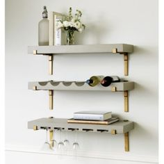 With its shallow profile, our Abbott Slim Shelf is a perfect for tighter spaces in the living room, kitchen or bath. Two bottom shelves have rails to keep bottles, glassware or toiletries in place. Abbot Slim Shelf features: Makes a space-saving vertical barCrafted of ironKeyholes for hanging
