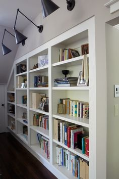 Love the built-ins with over-lighting...  Great if there was an open space for a TV.  :-)