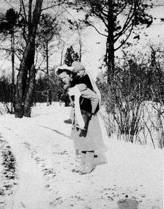 Grand Duchess Olga Nikolaevna carrying her brother Tsarevich Alexei Nikolaevich