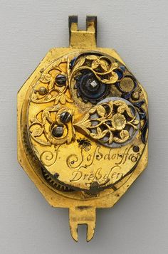 Detail, watch, c. 1630 - 1640. Movement by Johann Possdorffer, The case is made of rock crystal and gold, and partly enameled. The dial is painted enamel on gold, with a single gold hand. The movement is made of gilded brass and steel