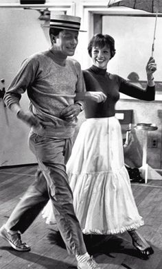 """Dick Van Dyke and Julie Andrews filming the """"Step in Time"""" sequence which had to be done twice because of a scratch on the film from the first take. The entire sequence took a week to film. - Mary Poppins (1964)"""