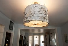 Woodstock Chandelier. Handmade shade of Birch Bark and varying construction materials (Woodstock, NY). This light is constructed from bark collected along the path to Overlook Mountain.  It has been stripped, carried (down a mountain), washed, flattened, coaxed, and stitched to make its way to you. My hope is that its glow will illuminate your home in the same way creating it lights up my heart.