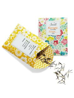 Create floral patterned packets from craft paper ahead of time using WD's mini seed packet template. Also, print a sheet or two of packet labels onto adhesive-backed paper. Arrange these materials on the seed swap table with some markers so guests can repackage and label them with the plant name, who provided the seeds and any special planting instructions. #Gardening