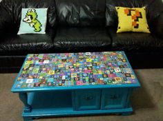 My husband and I spent 6 months working on this coffee table, it is 401 tiles of images from old school video games.