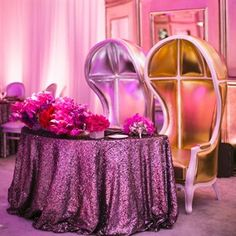 Kelly and Andrew sat at a glam sweetheart table at the head of the reception space. Sequined linens, shades of purple and fuchsia www.aboutdetailsdetails.com