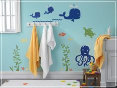 Create an underwater scene on the bathroom walls with decals — like this Under the Sea Wall Decal Mural Set ($80), including dolphins, whales, octopuses, and turtles! Your tot will have lots of fun splish-splashing along with his favorite