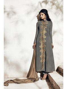 Grey Georgette Top With Matching Santoon Bottom. Jack Look Top Embellished With Zari And Crystal Work. This Dress Complete With Beige Chiffon Dupatta With All Over Hand Bootis. Item Code Nairra 1009-A