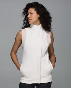 Versa Vest-When we're heading from sweat to street, we reach for comfortable layers that let us breathe yet still hold in our heat. This Cotton Fleece fabric vest was designed to keep our core warm as we transition from our focus on fitness to a caffeine-fueled walk with friends.