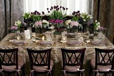 Grouping each flower type separately and using smaller vases of varying heights will give your tables the look of an abundant garden.