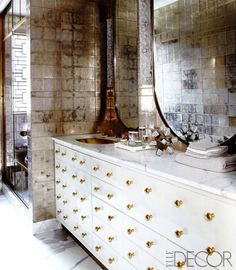 Cameron Diaz's bathroom is gold and glamorous. Learn how to translate her style into your apartment bathroom!