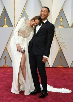 Chrissy Teigen and John Legend are couple goals on The Oscars red carpet! Chrissy is looking absolutely stunning in her Zuhair Murad gown!