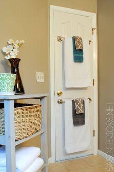 Use door for storage 10 Ways To Make A Small Bathroom Look Big
