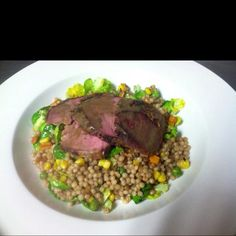 Roasted Leg of Lamb over Vegetable Couscous!