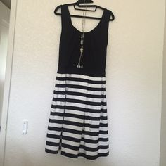 Black and stripes dress Sexy chic black dress. Cutout back. Never worn. Forever 21 Dresses Midi