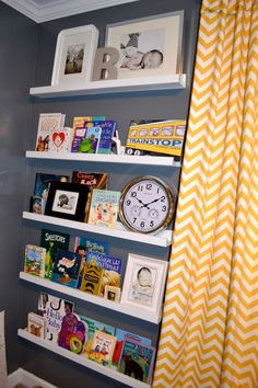 I plan on doing this in our nursery behind the opened door. I love chevron print too. The shelves are at Ikea.