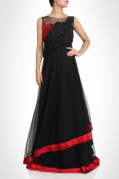 This black color gown is made in net fabric having satin silk inner layer. Hemline and neck is also designed in red satin gives it stunning look. Simple and sob