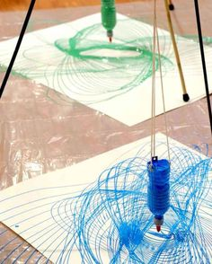Build an easy pendulum out of a water bottle filled with paint to make giant swirly patterns.