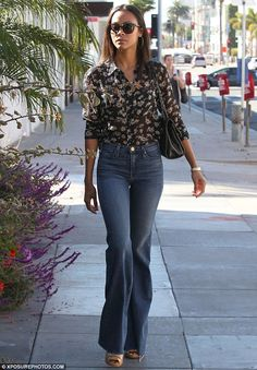 Off-duty: The 35-year-old wore her long hair down while wearing a pair of large, dark sunglasses