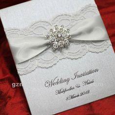 Resultados da Pesquisa de imagens do Google para http://img.alibaba.com/photo/541923549/silver_lace_wedding_invitations_with_brooch_wedding_favors_EA119.jpg