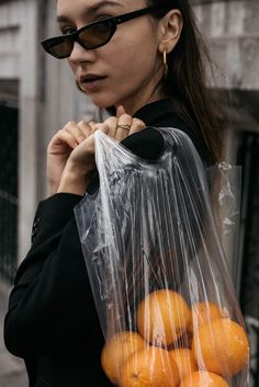 Fashion influencer Beatrice Gutu wearing Balenciaga inspired 2017 sunglasses in matrix editorial oranges in plastic bag ideas creative direction photography
