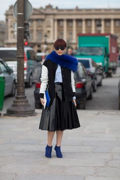 A blue stole and shoes up the luxe factor on this 50s inspired ensemble.   - HarpersBAZAAR.com