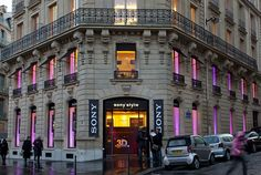 Outside: a facade scenically illuminated by Focalflood varychrome LED. Inside: brilliant Compact HIT downlights with Spherolit technology, fully controlled as a unified whole by a Light System DALI. The light in the Parisian Sony Store complements the image of the technology provider.     Architect:  Saguez & Partners, Saint-Ouen (F); Versions, Versailles (F)    Photographer:  Dirk Vogel, Dortmund    Place:  Paris
