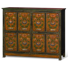 Hand-Painted Tibetan Cabinet. The expressive style of Tibetan art is beautifully manifested through this cabinet. Each flower was painstakingly hand-painted in a beautifully symmetric design, giving each panel perfect balance and making this a truly timeless masterpiece. Tibetan furniture.