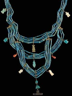 Africa | An Egptian Blue Faience Necklace; five-strands separated by modern spacers, and accented by the addition of thirteen amulets as pendants including two eyes of Horus, a Pataikos, a Bes, and two male genitalia, with some modern elements | Late period, Dynasty XXVI - XXX, 664-343 BC. | Sold 2115$