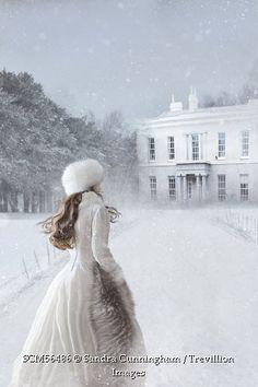 Trevillion Images - woman-walking-in-winter-snow-scene