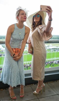 Sky Sports presenter Olivia Wayne (right) snaps a selfie with a friend to mark their day o...