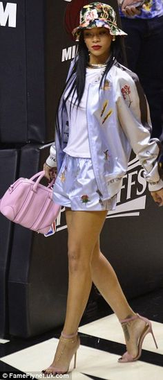 http://news-all-the-time.com/2014/05/09/rihanna-displays-her-long-legs-in-tiny-shorts-as-she-sits-courtside-to-watch-the-brooklyn-nets-take-on-miami-heat/ - Rihanna displays her long legs in tiny shorts as she sits courtside to watch the Brooklyn Nets take on Miami Heat  - By Claudette Davies  While the action on the court was no doubt exciting, it's likely many fans at the Brooklyn Nets vs Miami Heat were distracted from the game.  For pop superstar Rihanna was sitting
