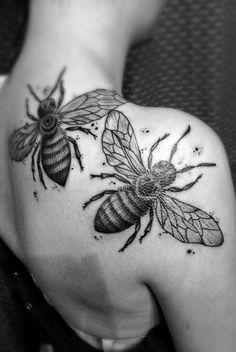 Bee tattoos.