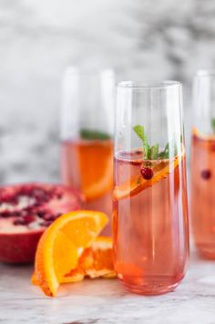 Impress your friends and family this holiday season with this super simple champagne punch recipe. It's void of sugary syrups and features fresh fruits, so you can feel better about your festive drink of choice! #holidaydrinks #christmaspunch #recipes #openfit Champagne Punch Recipes, Alcoholic Punch Recipes, Champagne Drinks, Drinks Alcohol Recipes, Yummy Drinks, Drink Recipes, Cocktail Drinks, Healthy Drinks, Holiday Punch