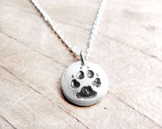 Hey, I found this really awesome Etsy listing at https://www.etsy.com/listing/62938952/tiny-dog-paw-print-necklace-silver-dog