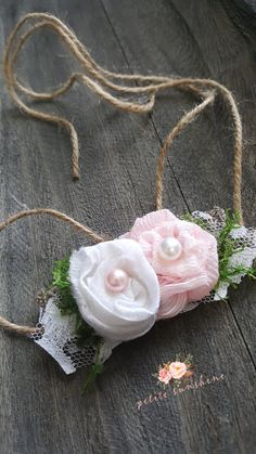 Floral newborn tieback, baby headband, baby girl photo prop, floral crown, newborn tieback, baby tieback, baby girl headband, lace headband This adorable tieback will fit up to adult size!! Set on jute, hemp twine adorned with lace and 2 handmade flowers with pearls! Please