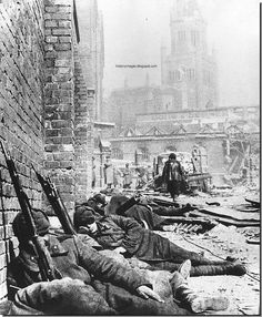 Exhausted Russian soldiers sleep on the street of Koenigsberg. April 1945