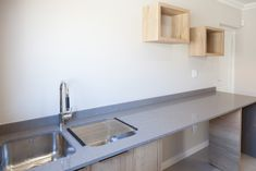 Clean and simple design open plan layout with functional spaces,natural wood textures add warmth. Designer home in Langebaan Country Estate. Country Estate, Modern Country, Shelving Display, Laundry Design, Interior Architecture, Interior Design, Timber Wood, Undermount Sink, Wood Texture