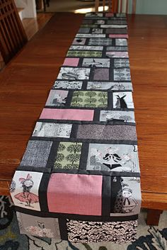 ghastlie table runner. Like this but with photos printed on fabric.