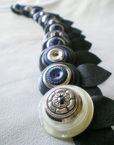 Bouttonieres for the groom and groomsmen made of vintage buttons and reclaimed leather.