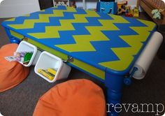 repurpose an old coffee table into your child's craft table!  Use inexpesive towel racks to hold rolls of paper and buckets!