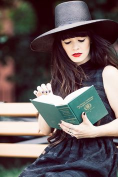 Reading the Norton Anthology in a Black Swan dress designed by Rachel-Marie Iwanyszyn. Hat c/o Worth & Worth. Photograph by Phil Van Nostrand