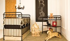 Black iron is a great choice for a small space because it commands attention without overpowering. The neutral tones complete the look for this lovely little nursery.