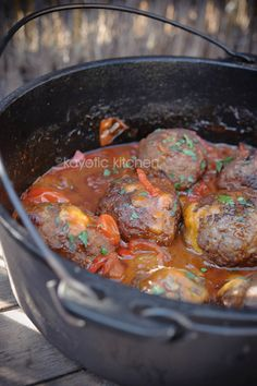 Mountain Meatballs. Meatballs filled with cheddar and simmered in a chili sauce.