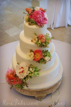 White Wedding Cake with Cascading Fresh Flowers.