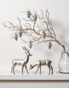 A beautiful holiday setting in silver. Love these little deer figurines. Perfect for a mantel or console table. Elegant Christmas, Scandinavian Christmas, Rustic Christmas, Modern Christmas, Christmas Mantels, Christmas Deer, White Christmas, Reindeer Decorations, Cake Decorations