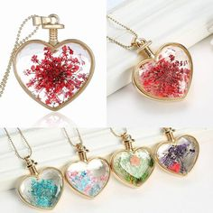 Resin encased flower heart pendant / https://www.wish.com/c/560a6d647323f3526a3a7635