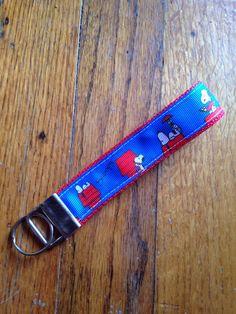 https://www.etsy.com/listing/527386166/ #snoopy #peanuts #doghouse #woodstock #keyfob #keychain #giftidea #etsygifts #handmade #handmadegift #cartoondog #keyholder #wristlet #sweetsixteen