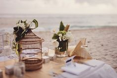 beach wedding. bird cages