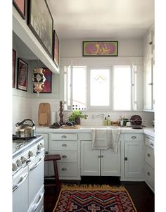 Lovely kitchen of Roman Alonso, the creative director of design firm Commune. From House Beautiful.